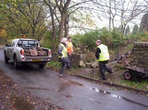 Staffordshire Wildlife Trust Volunteers moving stone to site.